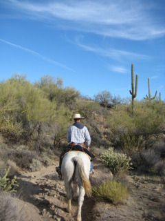 Wrangler Joe Ferguson leading an Arizona horseback riding vacation