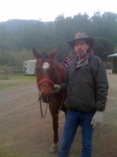 Adam and Hudina getting ready for a horseback riding vacation at Five Brooks Ranch