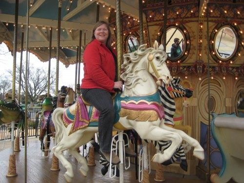 Nancy Brown on a horseback riding vacation on the Nut Tree Plaza Carousel in Vacaville, California