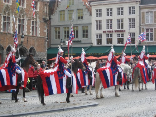 Holy Blood Procession flag holders on a horseback riding vacation in Bruges, Belgium