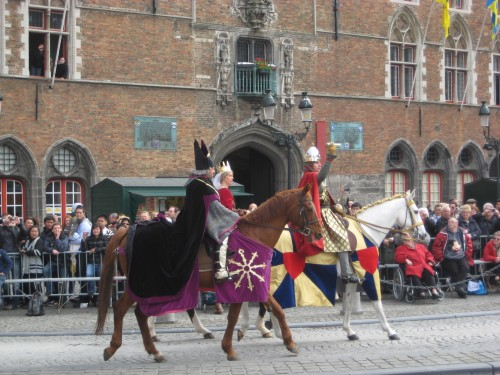 Horseman carrying the Holy Blood and accompanying royalty on a horseback riding vacation in Bruges, Belgium