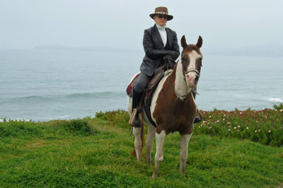 Willa Chapman of Coastal Horseback Riding Adventures leads a horseback riding vacation in Half Moon Bay, California