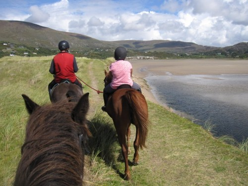 Rider being led on horseback riding vacation with Eagle Rock Equestrian Centre in Country Kerry, Ireland