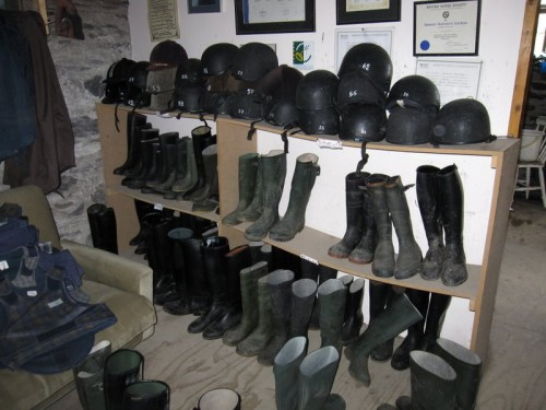 Riding boots and helmets await an Eagle Rock horseback riding vacation
