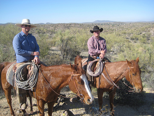 Rancho de los Caballeros Wrangler Dallas and Corral foreman Willum Malernee lead a horseback riding vacation in Sonoran desert at Rocky Ridge Overlook.