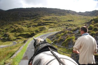 Dawn and Shane of Gap Poneymen lead a horse cart through the Gap of Dunloe - an alternative to a horseback riding vacation in County Kerry, Ireland