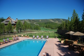 Go for a swim after a horseback riding vacation at The Club at Spanish Peaks in Big Sky, Montana