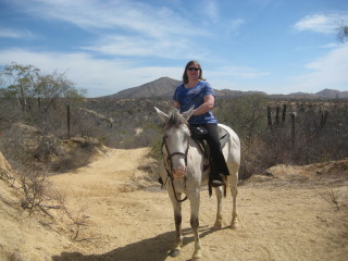 Nancy Brown and Chicharito on a Cuadra San Francisco horseback riding vacation in Los Cabos, Mexico