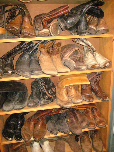Cowboy boots stand ready on your horseback riding vacation at Big Bar Guest Ranch