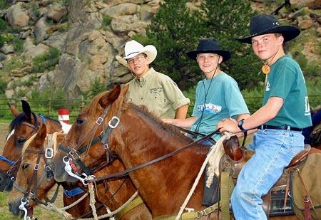 Cowboys on a horseback riding vacation at Tarryall River Ranch
