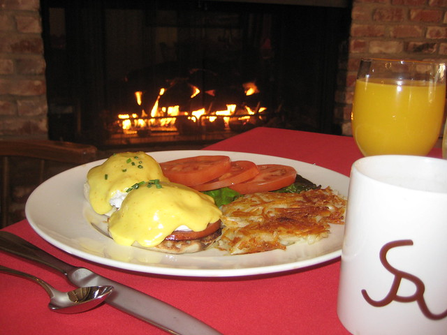 eggs benedict, hash brown potatoes, orange juice and coffee served in an Alisal Ranch coffee mug.