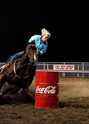 Barrel racing cowgirl takes a horseback riding vacation in Cody, Wyoming