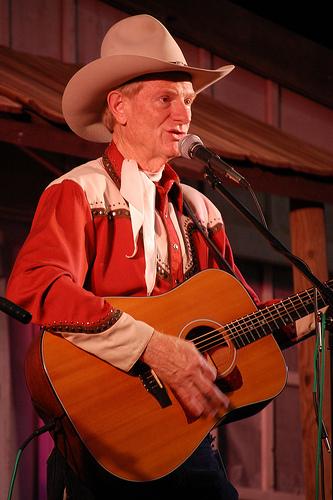 Singing cowboys serenade guests during a Cody Stampede horseback riding vacation in Wyoming