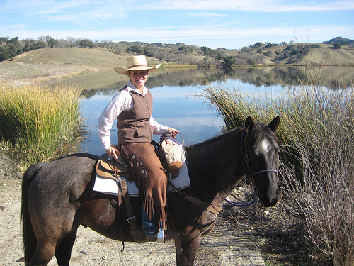 Alisal Wrangler Haddie Tal leads guests on Cowboy and Cowgirl Bootcamp Horseback Riding Vacations