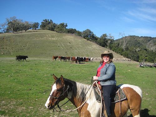 Nancy and Tonto on a horseback riding vacation at the Alisal Guest Ranch and Resort, Solvang, California