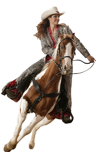 Take a horseback riding vacation with Dolly Parton and watch barrel racers at the Dixie Stampede