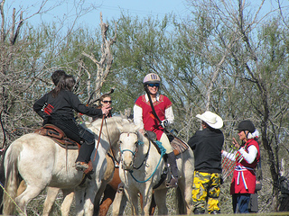 Equestrians work as a team to support the horses.
