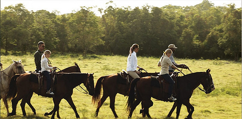 The Dominican Republic offers endless horseback riding vacation opportunities such as this family trail ride at Casa de Campo Resort.