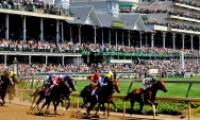 Horses round the first turn during Kentucky Derby at Churchill Downs