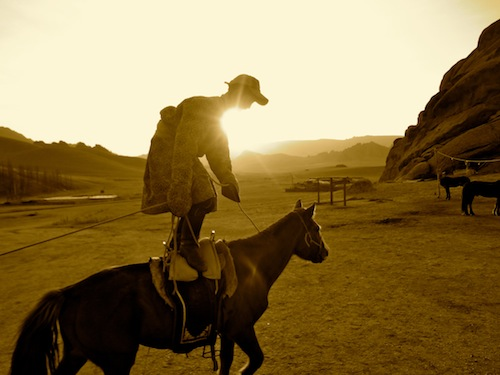 Our 10-year-old tour guide shows off during our horseback riding vacation in Mongolia