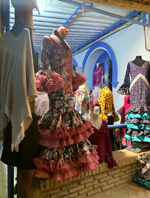 colorful flamenco dresses represent the clothes in El Rocío, Spain.