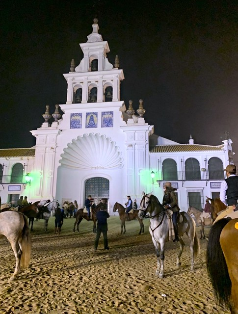 equestrians on horseback by El Rocio church, Spain