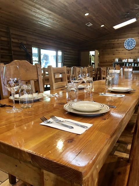 Long wooden table, set for family-dining at Greenhorn Ranch in the chuck house.
