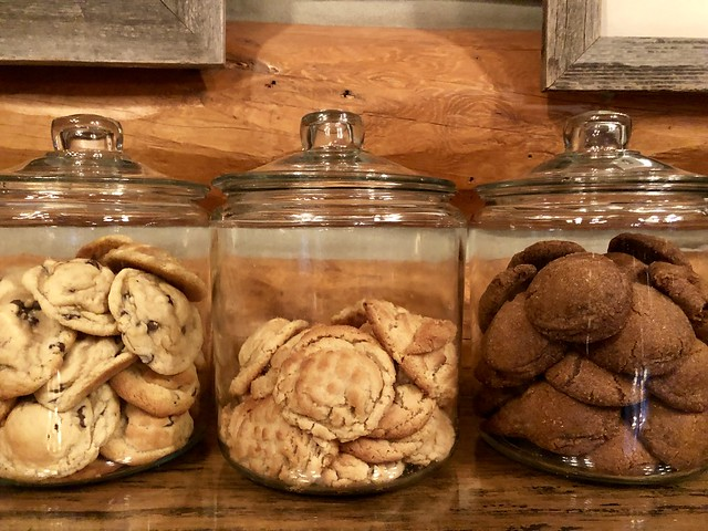 Three bottomless cookie jars at Covered Wagon Ranch include, left to right, chocolate chip, peanut butter and molasses cookies on the side board inside the lodge at Covered Wagon Ranch in Big Sky, Montana.