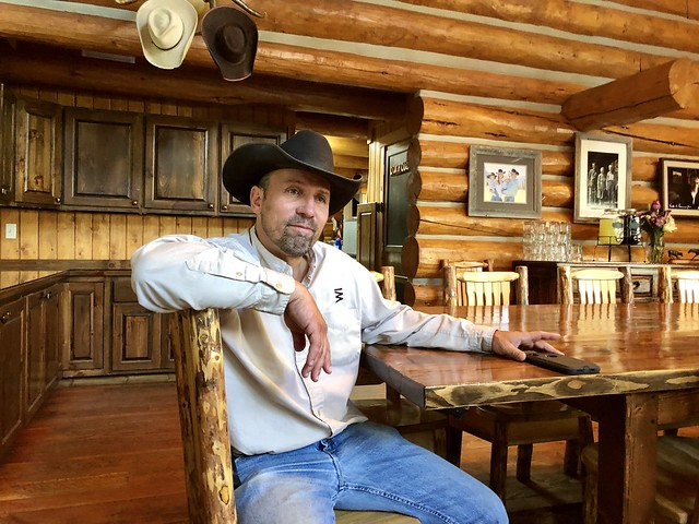 Cowboy Kurt Puckett shares why he loves owning Covered Wagon Ranch while he sits at the wood dining room table in the Montana lodge.