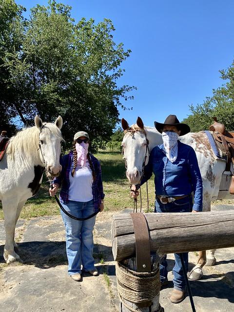 Melissa & Nancy Fiddler practice social distancing, while wearing bandanas, during a horseback ride at Rollin F. Ranch in Sebastopol, California