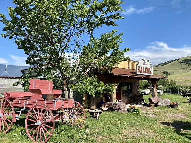 Antique wood wagon sits to the left of the Rocking Z Rusty Horseshoe Saloon in Wolf Creek, Montana.