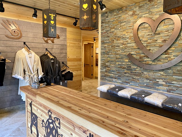 Rocking Heart Spa metal work on the wall of the Silvies Valley Ranch. Spa robes hang in the shop for sale in Seneca, Oregon.