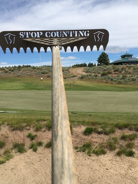 "Sand trap rake states ""Stop Counting"" to add humor to the golfers with balls stuck in the sand trap at Silvies Valley Ranch golf course."