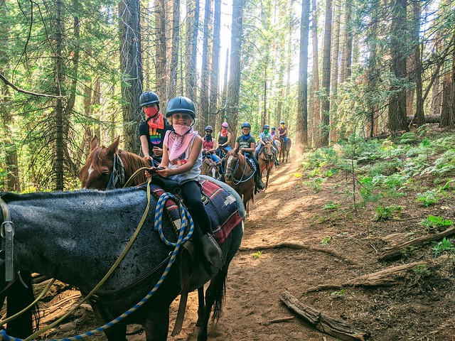 Six-year-old Gwen Bluhm and her family are all smiles while horseback riding in the Sierra National Forest in Madera County.